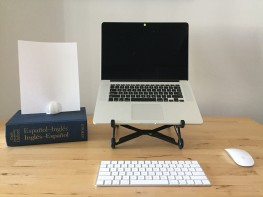 Use a stand to keep your computer screen at eye level and a page holder to prop up the text.