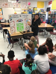 Jessica Sanchez explains the difference between translation and interpreting to students at Harrison Elementary School's Career Day in Lexington, Kentucky.